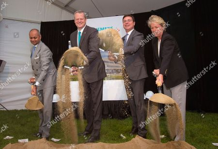 IMAGE DISTRIBUTED FOR SIEMENS HEALTHINEERS - From left, Michael Sen, Member of the Managing Board of Siemens AG and Siemens Healthcare GmbH Supervisory Board Chairman, Massachusetts Governor Charles Baker, Franz Walt, President of Laboratory Diagnostics, Siemens Healthineers and Lisa Davis, Chair and CEO of Siemens Corporation and Member of the Managing Board of Siemens AG break ground during a ceremony in Walpole, Mass. The expansion will create up to 700 new high-tech jobs over the next 10 years