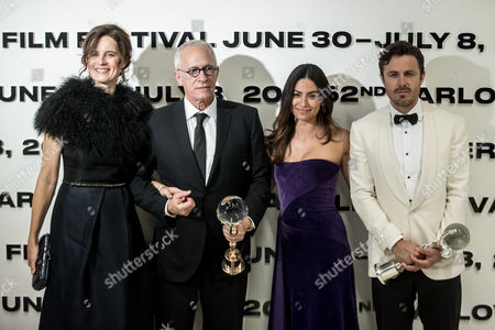 US composer James Newton Howard (2-L) and his wife Sophie (L) pose with Crystal Globe for Outstanding Contribution to World Cinema and US actor Casey Affleck (R) and his girlfriend Floriana Lima (2-R) pose with a Festival President's Award after the opening ceremony of the 52nd Karlovy Vary International Film Festival, in Karlovy Vary, Czech Republic, 30 June 2017. The festival runs from 30 June to 08 July.