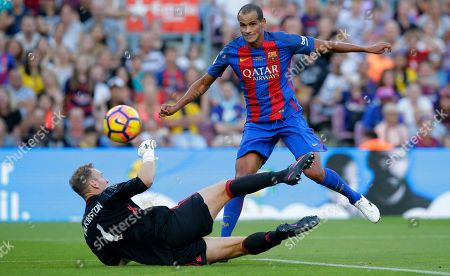 Rivaldo, Kevin Pilkington Former FC Barcelona player Rivaldo, right, duels for the ball against Former Manchester United goalkeeper Kevin Pilkington during the friendly soccer match between FC Barcelona legends and Manchester United legends at the Camp Nou stadium in Barcelona, Spain, Friday, June, 30, 2017