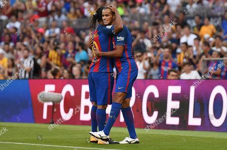Ronaldinho and Rivaldo of FC Barcelona.
