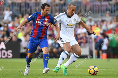 Mikael Silvestre of Manchester United Legends and Ludovic Giuly of FC Barcelona Legends.