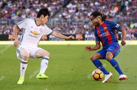 Edgar Davids of FC Barcelona Legends Park Ji Sung of Manchester United Legends.