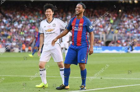 Ronaldinho of FC Barcelona Legends Park Ji Sung of Manchester United Legends.