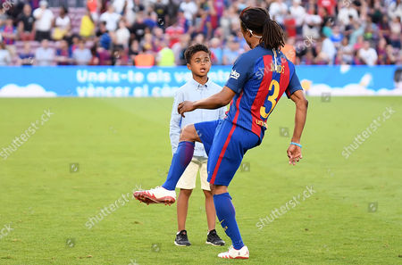 Edgar Davids of FC Barcelona Legends plays with Patrick Kluivert son.