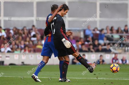 Raymond Van der Gouw of Manchester United and Rivaldo of FC Barcelona.