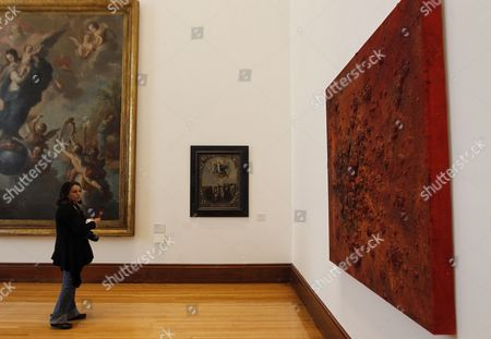 A visitor observes an untitled work (R) of Mexican contemporary artist Bosco Sodi during the exhibition 'Por los siglos de los siglos' (lit. For the centuries of the centuries) at the National Museum of Art in Mexico City, Mexico, 30 June 2017.