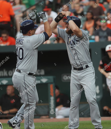 Tampa Bay Rays C Wilson Ramos (40), left, is congratulated by Tampa Bay Rays RF Steven Souza Jr. (20) after his home run int he second inning of a game against the Baltimore Orioles at Oriole Park at Camden Yards in Baltimore, MD on Photo/ Mike Buscher / Cal Sport Media