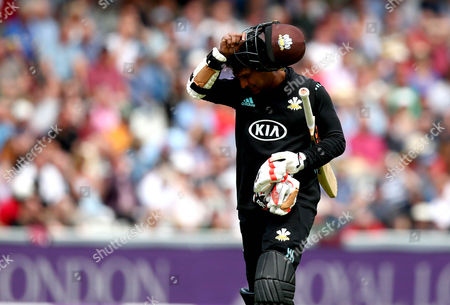 Kumar Sangakkara of Surrey cuts a frustrated figure after being dismissed by Steven Mullaney of Nottinghamshire