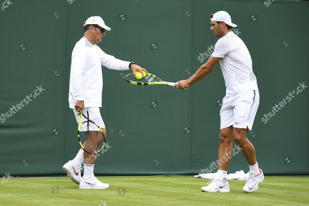 Rafael Nadal practices with his coach Toni Nadal