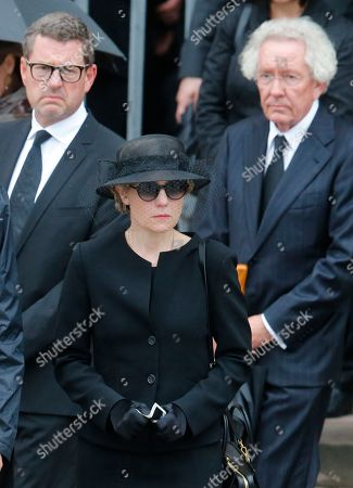 Maike Kohl-Richter, widow of late German Chancellor Helmut Kohl, center, Kai Diekmann, left, former editor-in-chief of German Bild newspaper, and Stephan Holthoff-Pfoertner, right, leave the cathedral after the requiem mass in the cathedral in Speyer, Germany, . Kohl died June 16 at the age of 87