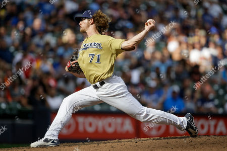 Stock Picture of Milwaukee Brewers' Josh Harder pitches to a Miami Marlins batter during the seventh inning of a baseball game, in Milwaukee