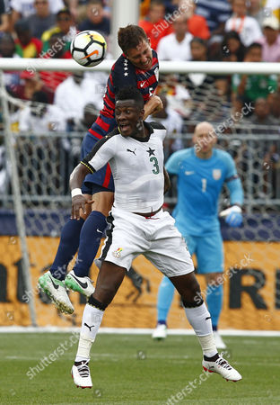 United States Men's National team Defender Matt Besler (L) and Ghana National team Forward Asamoah Gyan battle for the ball during the first half of their friendly match at Pratt and Whitney Stadium in East Hartford, Connecticut, USA 01 July 2017.