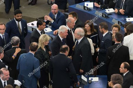 Bill Clinton and Hubert Vedrine attend a ceremony for late German Chancellor Helmut Kohl at the European Parliament in Strasbourg