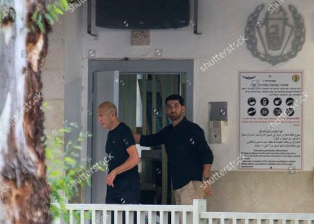 Stock Picture of Former Israeli Prime Minister Ehud Olmert, left, exits prison after his sentence, in Ramle, Israel, . The parole board of Israel's Prison Service has granted Olmert early release from prison. Prison Service spokesman Assaf Librati says the board granted Olmert's request to reduce a third of his 27-month incarceration sentence