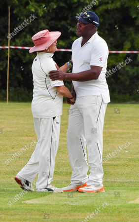 Stock Photo of Sir Martin Sorrell shakes hands with Devon Malcolm