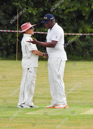 Sir Martin Sorrell shakes hands with Devon Malcolm