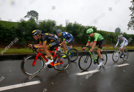 Taylor Phinney of the U.S., second right, rides in the breakaway with France's Thomas Boudat, left, France's Yoann Offredo, second left, and France's Laurent Pichon, right, during the second stage of the Tour de France cycling race over 203.5 kilometers (126.5 miles) with start in Dusseldorf, Germany, and finish in Liege, Belgium, . Phinney took the best climber's dotted jersey
