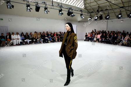 A model displays a creation by Belgian fashion designers An Vandevorst and Filip Arickx during the presentation of the A.F. Vandevorst Haute Couture Fall/Winter 2017/2018 fashion collection presented in Paris