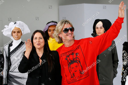Belgian fashion designers An Vandevorst and Filip Arickx acknowledge audience applause after the presentation of the A.F. Vandevorst Haute Couture Fall/Winter 2017/2018 fashion collection presented in Paris