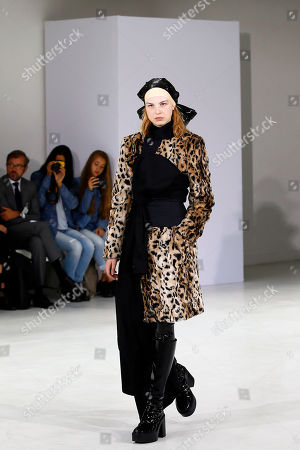 A model displays a creation by Belgian fashion designers An Vandevorst and Filip Arickx during the presentation of the A.F. Vandevorst Haute Couture Fall/Winter 2017/2018 fashion collection in Paris