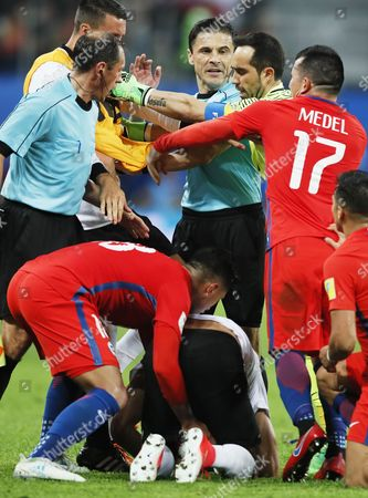 Gonzalo Jara (L) and Gary Medel (R) of Chile try to take the ball from Emre Can of Germany during the FIFA Confederations Cup 2017 final match between Chile and Germany at the Saint Petersburg stadium in St.Petersburg, Russia, 02 July 2017.