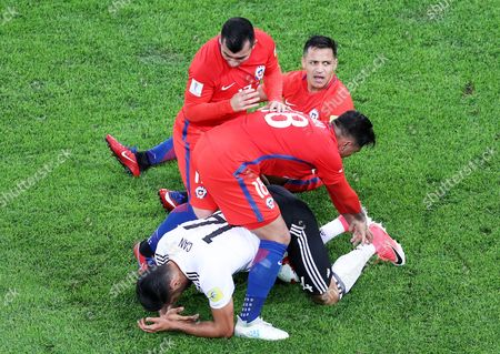 Gonzalo Jara (18) and Gary Medel of Chile try to take the ball from Emre Can of Germany during the FIFA Confederations Cup 2017 final match between Chile and Germany at the Saint Petersburg stadium in St.Petersburg, Russia, 02 July 2017.