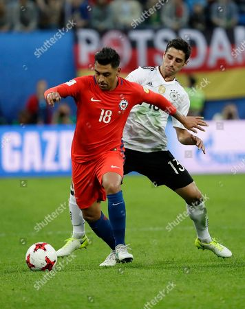 Chile's Gonzalo Jara, left, fights for the ball against Germany's Lars Stindl, center, and Germany's Timo Werner during the Confederations Cup final soccer match between Chile and Germany, at the St.Petersburg Stadium, Russia