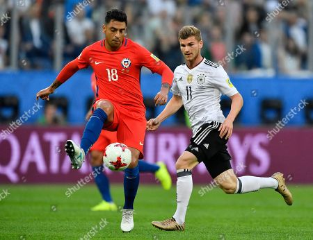 Chile's Gonzalo Jara, left, and Germany's Timo Werner challenge for the ball during the Confederations Cup final soccer match between Chile and Germany, at the St.Petersburg Stadium, Russia