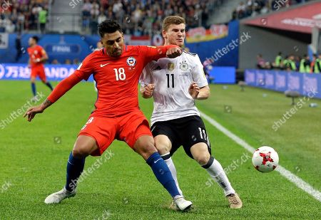 Chile's Gonzalo Jara clashes with Germany's Timo Werner, right, during the Confederations Cup final soccer match between Chile and Germany, at the St.Petersburg Stadium, Russia