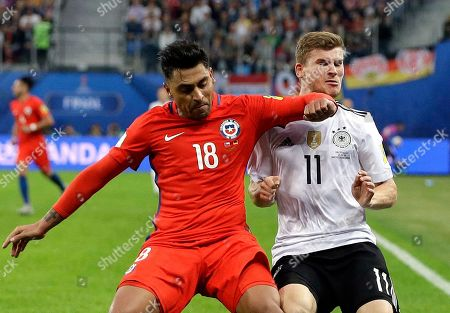 Chile's Gonzalo Jara fouls Germany's Timo Werner, right, during the Confederations Cup final soccer match between Chile and Germany, at the St.Petersburg Stadium, Russia