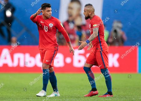 Chile's Gonzalo Jara, left, and Arturo Vidal leave the pitch at half time, during the Confederations Cup final soccer match between Chile and Germany, at the St.Petersburg Stadium, Russia