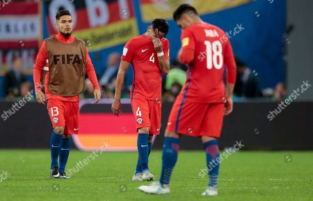 Chile's Gonzalo Jara, right, and Mauricio Isla at the end of the Confederations Cup final soccer match between Chile and Germany, at the St.Petersburg Stadium, Russia, . Germany won 1-0