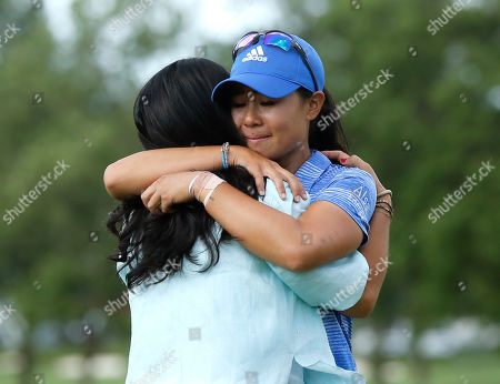 Grace Lee, Danielle Kang Danielle Kang, right, is hugged by her mom Grace Lee after Kang won the Women's PGA Championship golf tournament at Olympia Fields Country Club, in Olympia Fields, Ill