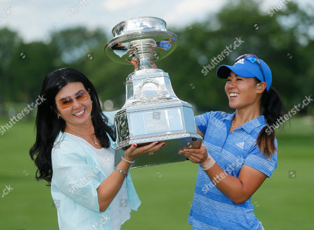 Danielle Kang, Grace Lee Danielle Kang, right, poses with with her mom Grace Lee and the championship trophy after winning the Women's PGA Championship golf tournament at Olympia Fields Country Club, in Olympia Fields, Ill