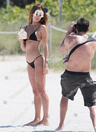 Stock Photo of Natalia Borges in a bikini with her fiance and their dog at the beach
