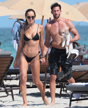 Natalia Borges in a bikini with her fiance Michael and their dog at the beach