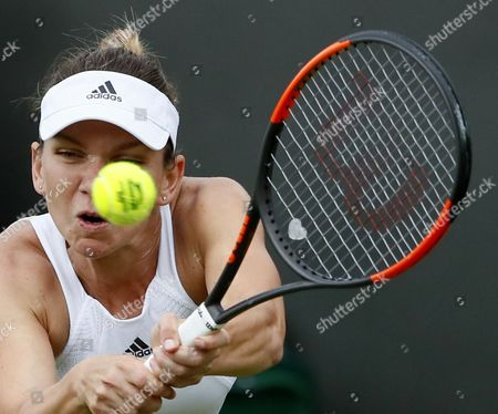 Simona Halep of Romania in action against Marina Erakovic of New Zealand during their first round match for the Wimbledon Championships at the All England Lawn Tennis Club, in London, Britain, 03 July 2017.
