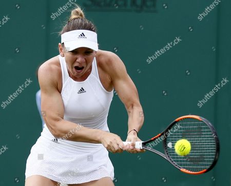 Stock Picture of Simona Halep of Romania in action against Marina Erakovic of New Zealand during their first round match for the Wimbledon Championships at the All England Lawn Tennis Club, in London, Britain, 03 July 2017.