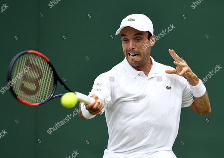 Roberto Bautista Agut of Spain returns to Andreas Haider-Maurer of Austria in their first round match during the Wimbledon Championships at the All England Lawn Tennis Club, in London, Britain, 03 July 2017.