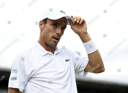 Roberto Bautista Agut of Spain plays Andreas Haider-Maurer of Austria in their first round match during the Wimbledon Championships at the All England Lawn Tennis Club, in London, Britain, 03 July 2017.