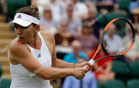 Romania's Simona Halep returns to New Zealand's Marina Erakovic during their Women's Singles Match on day one at the Wimbledon Tennis Championships in London