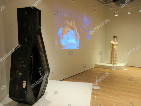 This photo shows a jazz exhibition in Newark, N.J., with Ella Fitzgerald performing on video next to the gown she was wearing. The exhibition, organized by Rutgers University's Institute of Jazz Studies, can be seen at the Paul Robeson Galleries at Express Newark, an arts incubator inside the old Hahne & Co. department store, which stood vacant for 30 years until reopening this year with retailers, apartments and the arts. Riots scarred Newark 50 years ago this summer, but tourism officials are hoping to attract more visitors as the city charts its comeback