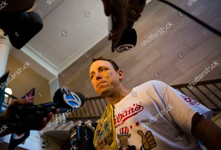 The current world hot dog eating champion, Joey Chestnut speaks to media after the Nathan's Famous Hotdog eating contest weight in, in Brooklyn, New York. Chestnut weight in at 220.5 and will be defending his title from Matt Stonie who has defeat Chestnut in the past