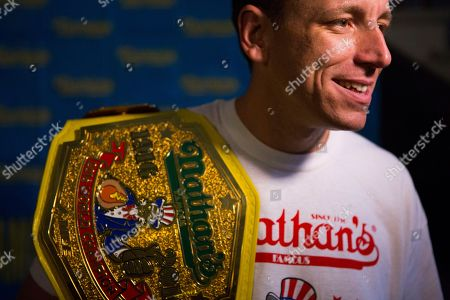 The current world hot dog eating champion, Joey Chestnut speaks to the media after the Nathan's Famous Hotdog eating contest weight in, in Brooklyn, New York. Chestnut weight in at 220.5 and will be defending his title from Matt Stonie who has defeat Chestnut in the past