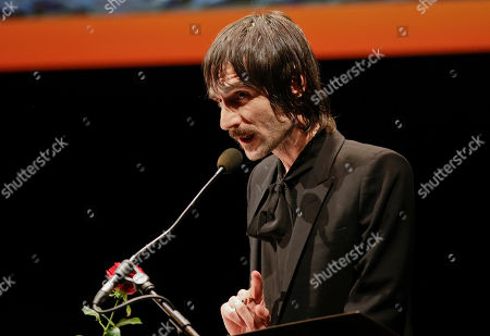 Italian writer and songwriter of music group Baustelle, Francesco Bianconi, reads his book during 'La Milanesiana' cultural event, at the Piccolo Teatro Grassi, in Milan, Italy