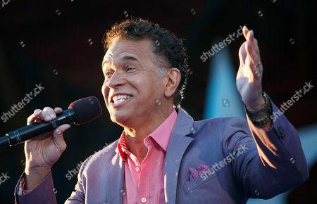 Brian Stokes Mitchell performs during a rehearsal for the annual Boston Pops Fireworks Spectacular on the Esplanade, in Boston