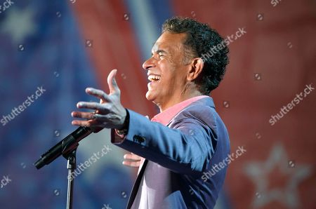 Brian Stokes Mitchell performs during rehearsal for the annual Boston Pops Fireworks Spectacular on the Esplanade, in Boston