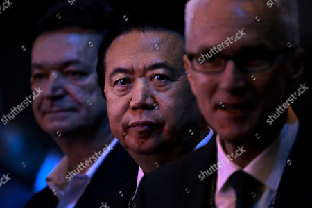 Interpol President, Meng Hongwei, center waits to deliver his opening address at the Interpol World congress, in Singapore