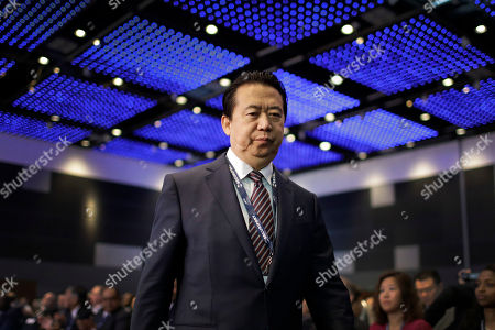 Interpol President, Meng Hongwei, walks towards the stage to deliver his opening address at the Interpol World congress, in Singapore