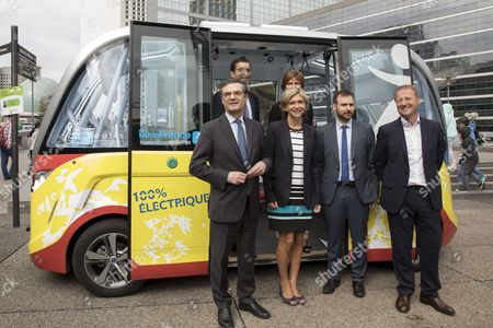 (L-R) Chief Executive Officer (CEO) of public transport company Keolis Jean-Pierre Farandou, President of the General Council of Hauts-de-Seine Patrick Devedjian, President of the Ileana Cabra de France Region Valerie Pecresse and CEO of Navya Christophe Sapet, stand in a new bus shuttle, launched by Keolis, Navya and the Stif, in the business district of La Defense.